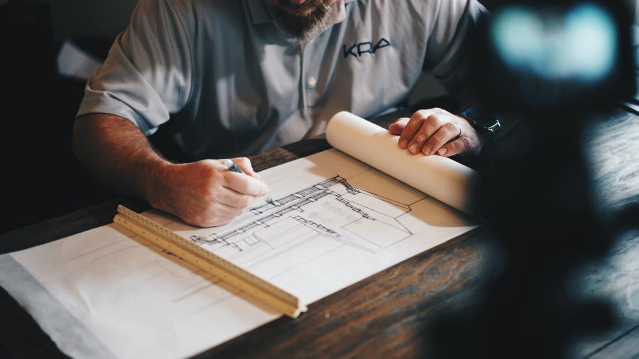 Architect drawing - Photo by Daniel McCullough on Unsplash