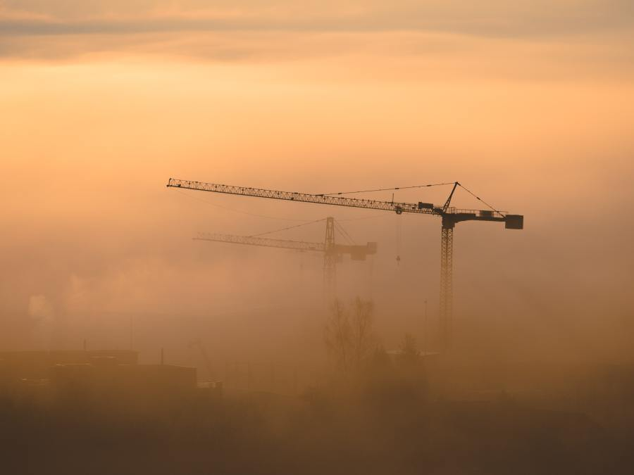 Cranes Poking through Clouds - Photo by Verstappen Photography on Unsplash